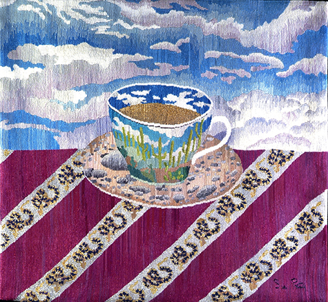 Cup with aDesert Landscape on a Snake Table Cloth